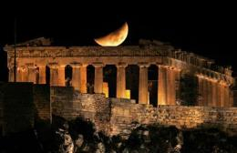 File picture of a crescent moon over the Parthenon atop Athens' ancient Acropolis