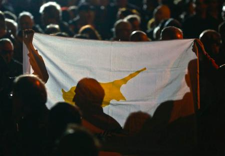 protesters_hold_a_flag_of_cyprus_during_an_anti_ba_5153463eb01402502288