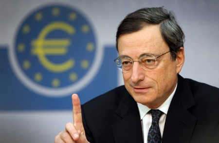 "The European Central Bank's new chief Mario Draghi gestures during his first press conference at the ECB in Frankfurt/M., western Germany, on November 3, 2011. The European Central Bank's decision to cut its key interest rates in a surprise move was ""unanimous"", the 64-year-old Italian said. Draghi's first few days as ECB president have certainly been a baptism of fire. The 17-nation eurozone is back in deep crisis following the shock call by Greece for a national referendum on a debt rescue reached with huge difficulty only last week. Draghi took over at the helm of the ECB from Jean-Claude Trichet.     AFP PHOTO / DANIEL ROLAND (Photo credit should read DANIEL ROLAND/AFP/Getty Images)"