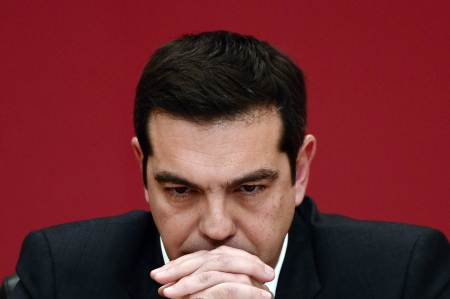 TOPSHOTS The leader of the leftist Syriza party, Alexis Tsipras, listens to a question during a televised press conference on January 23, 2015 at the Zappion Hall in Athens. Greeks vote on January 25 in a general election for the second time in three years, with radical leftists Syriza leading the polls with a promise to renegotiate the international bailout that has imposed five years of austerity on the country.   AFP PHOTO/LOUISA GOULIAMAKI