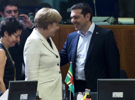 German Chancellor Angela Merkel (L) talks with Greek Prime Minister Alexis Tsipras (R) at the start of an EU-CELAC Latin America summit in Brussels, Belgium June 10, 2015.   REUTERS/Yves Herman